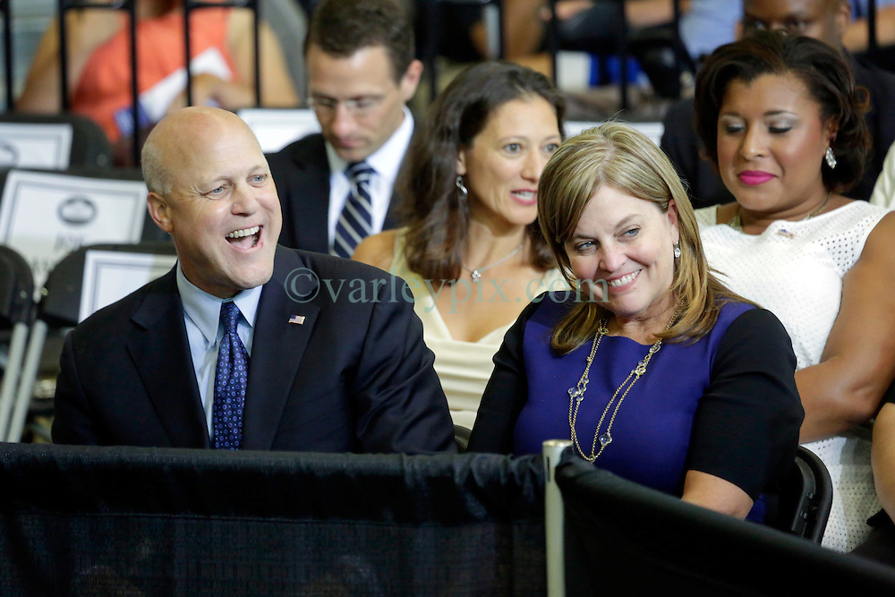 27 August 2015. Andrew P. Sanchez &amp; Copelin-Byrd Multi Service Center, Lower 9th Ward, New Orleans, Louisiana.<br /> Mayor Mitch Landrieu and his wife Cheryl Quirk await remarks from President Barack Obama speaks. <br /> Photo credit&copy;; Charlie Varley/varleypix.com.