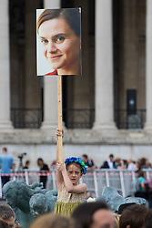 Trafalgar Square, London, June 22nd 2016. Thousands of people flood London's Trafalgar Square to celebrate what would have been slain Labour MP for Batley & Spen Jo Cox's 42nd birthhday. PICTURED: A girl holds a placard bearing Jo Cox's face aloft.