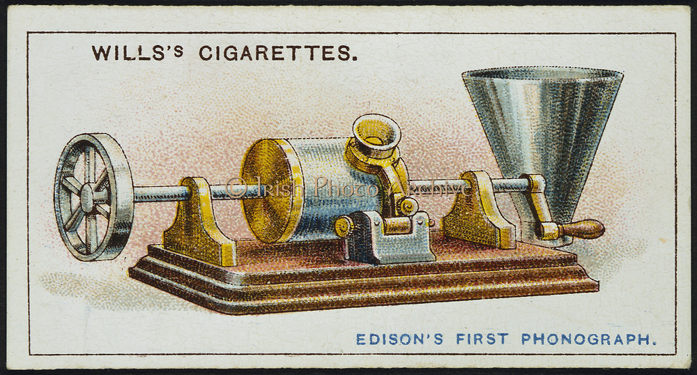 Thomas Alva Edison's first Phonograph (1878). In this model the cylinder on which the sound was recorded had to be rotated by hand. Instrument in recording mode. The horn fitted for playing back recording is on right. From cigarette card published 1915. Chromolithograph