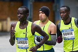 lead pack of men race down Westwdie Highway, Sambu,  Barrios, Korir, April