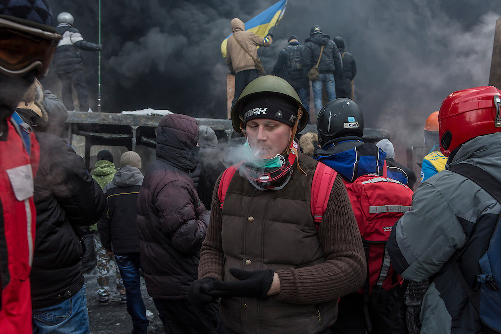 KIEV, UKRAINE - JANUARY 25: Anti-government protesters clash with police on Hrushevskoho Street near Dynamo stadium on January 25, 2014 in Kiev, Ukraine. After two months of primarily peaceful anti-government protests in the city center, new laws meant to end the protest movement have sparked violent clashes in recent days. (Photo by Brendan Hoffman/Getty Images) *** Local Caption ***