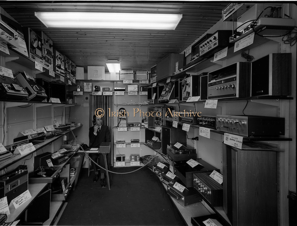 16/07/1970<br /> 07/16/1970<br /> 16 July 1970<br /> Interior of Hi-Fi Stereo, 108 St. Stephens Green, Dublin. Image shows the shop cointer (desk) and a range of the radios, recorders, players and speakers (amplifiers) the store sold. Brands include Sony ad National.