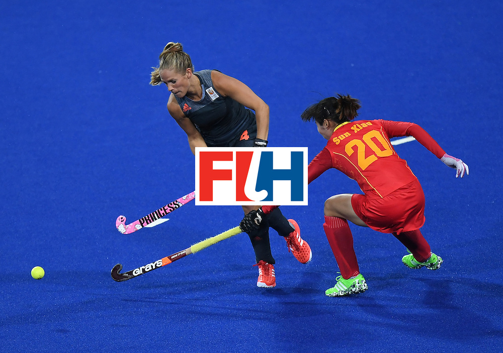 Netherland's Kitty van Male (L) vies for the ball with China's Sun Xiao during the women's field hockey China vs Netherlands match of the Rio 2016 Olympics Games at the Olympic Hockey Centre in Rio de Janeiro on August, 10 2016. / AFP / MANAN VATSYAYANA        (Photo credit should read MANAN VATSYAYANA/AFP/Getty Images)