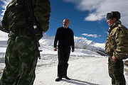 Vitali Kaloyev on the Caucasian mountains with guards near his hometown of Vladikavkaz, in North Ossetia in southern Russia. .The 52-year-old architect, who killed the air traffic controller blamed for the plane crash in which he lost his wife and two children, is being treated as a national hero..Kaloyev, who was freed November 2007 from a Swiss jail after serving less than four years, was appointed deputy construction minister for his home region..Kaloyev was building a holiday villa in Spain for a wealthy Russian when his wife Svetlana, 44, 10-year-old son Konstantin and four-year-old daughter Diana, set out to join him for a holiday in July 2002. As their plane flew over Germany it collided with a cargo jet killing all 71 people on board, most of them Russian schoolchildren..Investigators later established that Peter Nielsen, a Dane working for Skyguide, the Swiss air-traffic control service at Zurich airport, was the only person on duty. He had panicked when he realised the two planes were on a collision course and gave wrong instructions to the pilots..Like other bereaved relatives, Kaloyev grew angry at the slow pace of the investigation and the way Skyguide, fearful of lawsuits, sought to place the blame on others..Kaloyev claims he cannot remember what happened next, but does not deny stabbing Nielsen several times with a pocket knife. Nielsen bled to death before an ambulance could reach him. Kaloyev was arrested the following day and was sentenced to eight years for manslaughter.