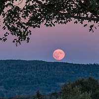 "A full ""Super moon"" rises from behind the White Mountains of central Vermont. Photographed near Cabot, Vermont."