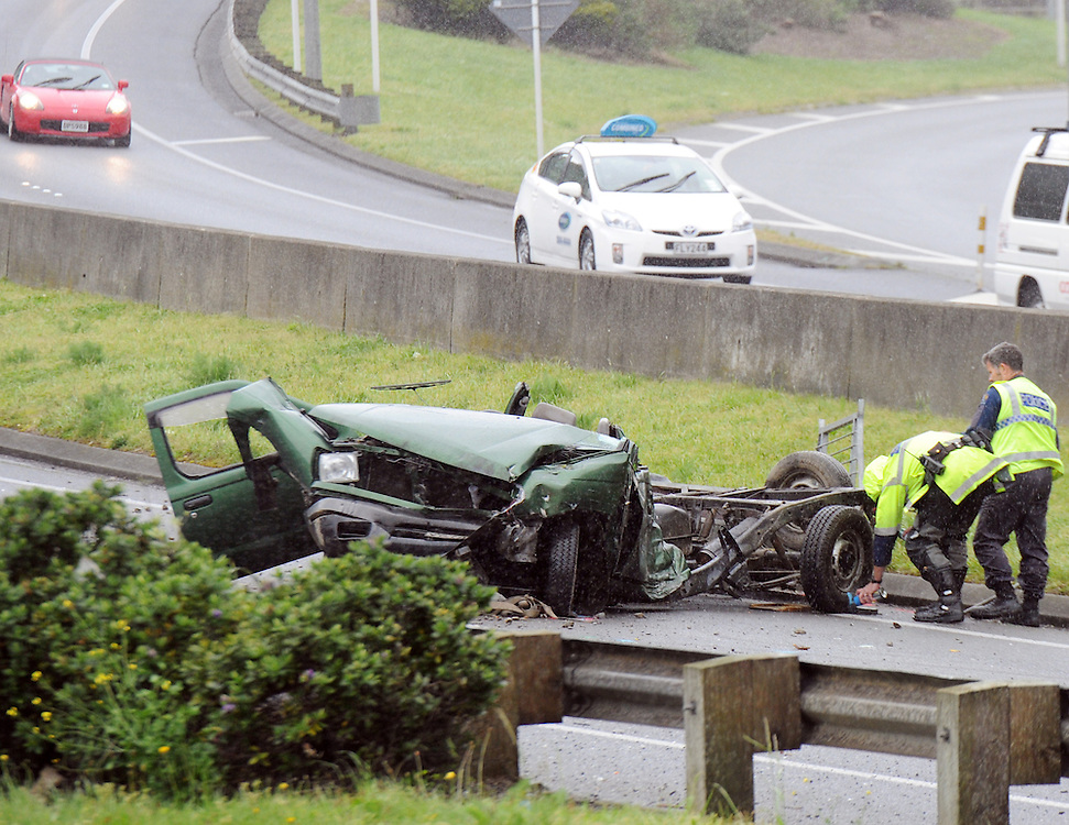 Police at the scene after a ute collided with a truck on the SH1 Motorway at the bottom of the Ngauranga Gorge, Wellington, New Zealand, Monday, October 14, 2013. Credit:SNPA / Ross Setford
