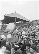 Crowds of supporters in the stands and on Hill 16 during the All Ireland Senior Gaelic Football final Dublin vs Derry in Croke Park on 28th September 1958. Dublin 2-12 Derry 1-9.