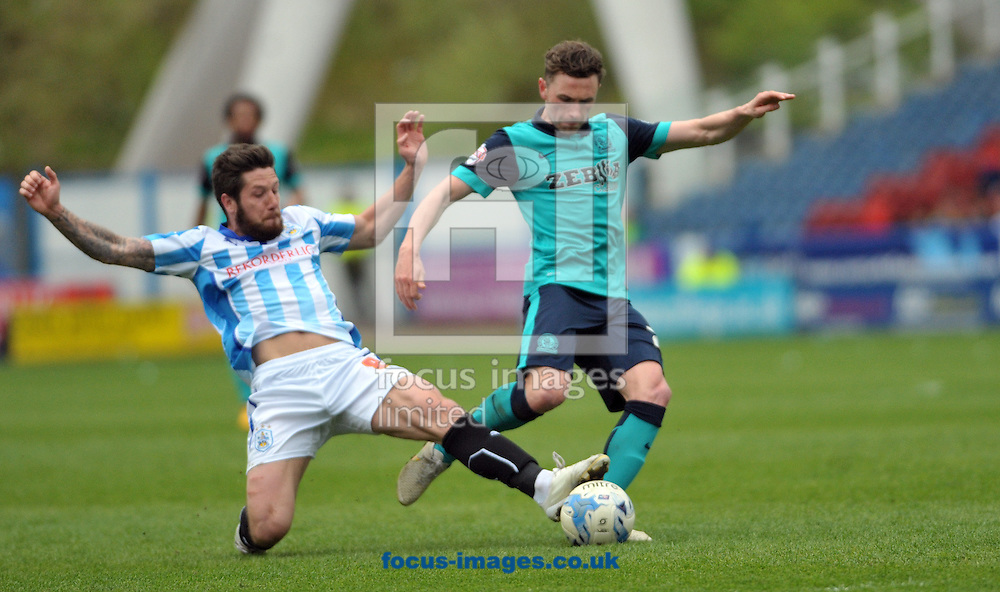 Jacob Butterfield of Huddersfield Town denys Paul Taylor of Blackburn Rovers a shot on goal during the Sky Bet Championship match at the John Smiths Stadium, Huddersfield<br /> Picture by Graham Crowther/Focus Images Ltd +44 7763 140036<br /> 25/04/2015