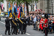 British Legion flag bearers march off and are saluteed by veterans after the memorial service in Whitehall. VE Day 70 commemorations - Three days of events in London and across the UK marking historic anniversary of end of the Second World War in Europe. Trafalgar Square, scene of jubilant celebrations marking the end of the Second World War in Europe on 8 May 1945, plays a central part in a host of national events, which include a Service of Remembrance at the Cenotaph, a concert in Horse Guards Parade, a Service of Thanksgiving at Westminster Abbey, a parade of Service personnel and veterans and a flypast.