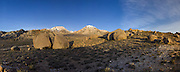 Panoramic image of morning light rising over the Buttermilk Country, Mt. Tom, and Basin Mountain in Bishop, CA.