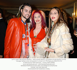 Left to right, MR ROCKY MAZZILLI , MRS LOUISE MAZZILLI and MISS TATUM MAZZILLI of the Voyage fashion store, at a party in London on 17th February 2003.	PHI 212