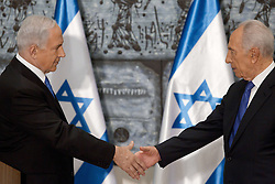 SHIMON PERES (2 August 1923 - 28 September 2016) was a Polish-born Israeli statesman. Born Szymon Perski, he was the ninth President of Israel from 2007 to 2014, served twice as the Prime Minister of Israel and twice as Interim Prime Minister, and he was a member of 12 cabinets in a political career spanning over 66 years. Peres won the 1994 Nobel Peace Prize together with Yitzhak Rabin and Yasser Arafat for the peace talks that he participated in as Israeli Foreign Minister, producing the Oslo Accords. PICTURED: Feb 2, 2013 - Jerusalem, Israel - Israeli Prime Minister BENJAMIN NETANYAHU (L) and Israeli President SHIMON PERES shake hands at the conclusion of a brief ceremony in the president's residence. (Credit Image: © Jim Hollander/Pool/Xinhua/ZUMAPRESS.com)
