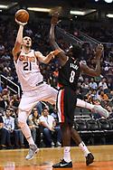 Oct 11, 2017; Phoenix, AZ, USA; Phoenix Suns center Alex Len (21) shoots the ball over Portland Trail Blazers forward Al-Farouq Aminu (8) in the first half at Talking Stick Resort Arena. Mandatory Credit: Jennifer Stewart-USA TODAY Sports