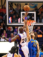 Nov. 23, 2012; Phoenix, AZ, USA; Phoenix Suns center Jermaine O'Neal (20) puts the ball up over the New Orleans Hornets center Robin Lopez (15) in the first half at US Airways Center. Mandatory Credit: Jennifer Stewart-US PRESSWIRE