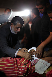 60622098<br /> Relatives mourn over a Palestinian man who was shot dead by an Israeli soldier at an army base north of Jerusalem on Thursday evening, during his funeral near the West Bank city of Bethlehem, on Oct. 21, 2013. According to an Israel s military spokesperson, the Palestinian man, driving a tractor, tried to break into the Rama camp near Ramallah, prompting a soldier to shoot at him, Monday Oct. 21, 2013. Picture by imago /  i-Images<br /> UK ONLY