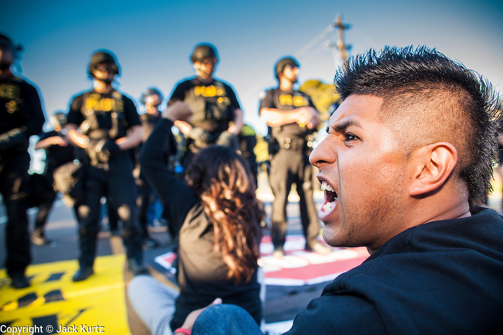 20 MARCH 2012 - PHOENIX, AZ: Hugo Sanchez (CQ) shouts at police during a student protest in support of the DREAM Act on 75th Ave in front of Trevor G. Browne High School Tuesday.   PHOTO BY JACK KURTZ