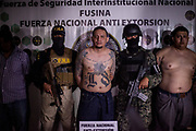 David Alberto Verde Bonilla, 23, 18th Street Gang member, was arrested for possesion of military weapons and presented to the press. 10th August 2017.