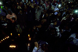 Eyes follow released balloons as they float away in the sky during a vigil for Akeem Mickens (professionally known as battle rapper Tech9) at the Happy Hollow playground, in Germantown, on Tuesday. (Bastiaan Slabbers for WHYY)