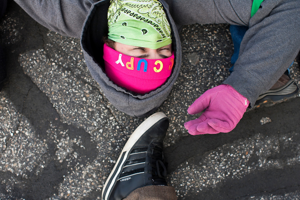 Kevin Bostwick and other Occupy protesters stage a die in at the offices of Organizing for America, President Obama's re-election organization, on Monday, January 9, 2012 in Manchester, NH. Brendan Hoffman for the New York Times