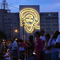 (092015  Havana, Cuba) The image of Cuban revolutionary hero Camilo Cienfuegos is lit up as Cubans and other pilgrims begin to gather at dawn for a Papal Mass at the Plaza de la Revolucion in Havana, Sunday,  September 20, 2015. photo by Angela Rowlings.
