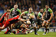 Picture by Andrew Tobin/Focus Images Ltd. 07710 761829. .27/12/11. Mike Brown (15) of Harlequins breaks the tackle of Ernst Joubert (8) of Saracens during the Aviva Premiership match between Harlequins and Saracens at Twickenham Stadium, London.