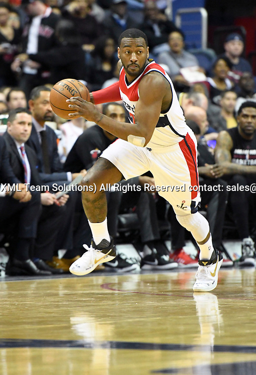 WASHINGTON, DC - APRIL 8: Washington Wizards guard John Wall (2) brings the ball up court in the first half  against the Miami Heat on April 8, 2017, at the Verizon Center in Washington, D.C.  The Miami Heat defeated the Washington Wizards 106-103.  (Photo by Icon Sportswire)