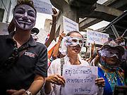 "02 JUNE 2013 - BANGKOK, THAILAND:  Anti government protesters in Bangkok. About 300 people wearing the Guy Fawkes mask popularized by the movie ""V for Vendetta"" and Anonymous, the hackers' group, marched through central Bangkok Sunday demanding the resignation of Prime Minister Yingluck Shinawatra. They claim that Yingluck is acting as a puppet for her brother, former Prime Minister Thaksin Shinawatra, who was deposed by a military coup in 2006 and now lives in exile in Dubai.    PHOTO BY JACK KURTZ"