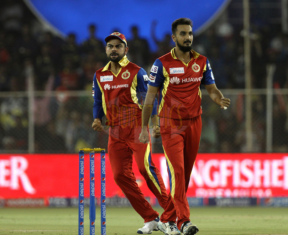 Royal Challengers Bangalore players celebrates the wicket of Rajasthan Royals player Ajinkya Rahane during match 22 of the Pepsi IPL 2015 (Indian Premier League) between The Rajasthan Royals and The Royal Challengers Bangalore held at the Sardar Patel Stadium in Ahmedabad , India on the 24th April 2015.<br /> <br /> Photo by:  Vipin Pawar / SPORTZPICS / IPL