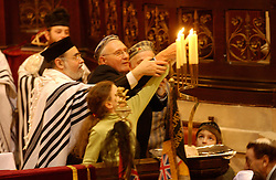 BRUSSELS, BELGIUM - JAN-30-2005 -  Concentration camp survivors and their families light candles during a memorial service with the help of Rabbi Albert Guigui at the Grand Synagogue in Brussels in remembrance of the liberation of the notorious Nazi concentration camp at Auschwitz. (REPORTERS © JOCK FISTICK)