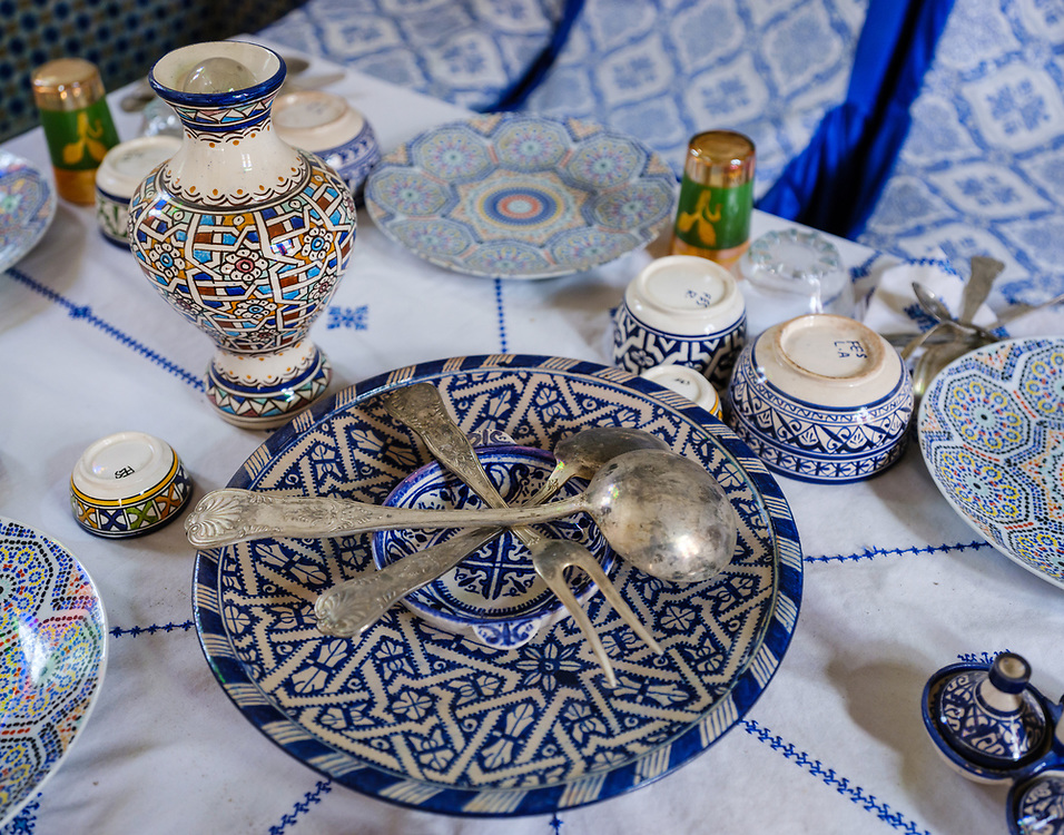 FEZ, MOROCCO - CIRCA APRIL 2017:  Old and classic Moroccan ceramic dishes and silverware.