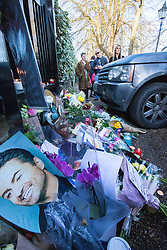 Highgate, London, December 26th 2016. Fans gather outside the London home of pop icon George Michael who died on Christmas day. PICTURED: The steadily growing collection of pictures, flowers and candles.