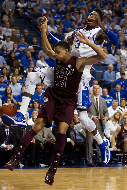 UK forward Nerlens Noel, back, is fouled by Texas A&M guard Jordan Green in the first half. The University of Kentucky Men's Basketball team hosted Texas A&M , Saturday, Jan. 12, 2013 at Rupp Arena in Lexington . Photo by Jonathan Palmer/Special to the Courier-Journal.