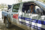 Health technician Rigoberto Martinez uses a car-mounted megaphone to announce vaccination being carried out at the primary school in the town of Coyolito, Honduras on Thursday April 25, 2013.