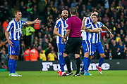 Brighton & Hove Albion winger Anthony Knockaert (11) is irate at tonights referee Tim Robinson after Norwich City forward Alex Pritchard (21) scores a goal  to make the score 1-0 during the EFL Sky Bet Championship match between Norwich City and Brighton and Hove Albion at Carrow Road, Norwich, England on 21 April 2017. Photo by Simon Davies.