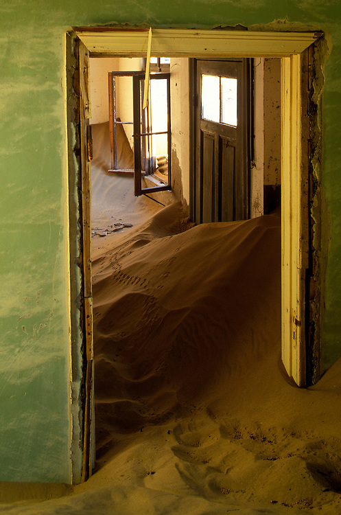 Africa, Namibia, Kolmanskop, Drifting sand fills building interior in abandoned diamond mining ghost town near Lüderitz
