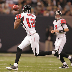2008 December, 07: Atlanta Falcons wide receiver Michael Jenkins (12) reaches for a pass thrown by quarterback Matt Ryan (2) during a 29-25 victory by the New Orleans Saints over NFC South divisional rivals the Atlanta Falcons at the Louisiana Superdome in New Orleans, LA.