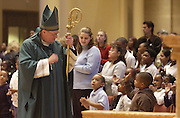 Archbishop Dolan greets children as he enters St. John the Evangelist Cathedral in Milwaukee in 2003. (Sam Lucero photo)