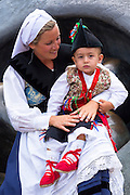 Mother and child at raditional fiesta at Villaviciosa in Asturias, Northern Spain