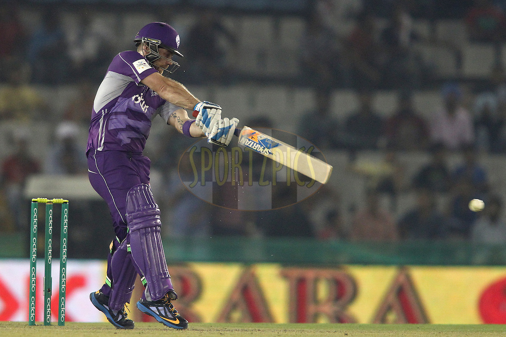 Aiden Blizzard of the Hobart Hurricanes square cuts a delivery during match 2 of the Oppo Champions League Twenty20 between the Kings XI Punjab and the Hobart Hurricanes held at the Punjab Cricket Association Stadium, Mohali, India on the 18th September 2014<br /> <br /> Photo by:  Shaun Roy / Sportzpics/ CLT20<br /> <br /> <br /> Image use is subject to the terms and conditions as laid out by the BCCI/ CLT20.  The terms and conditions can be downloaded here:<br /> <br /> http://sportzpics.photoshelter.com/gallery/CLT20-Image-Terms-and-Conditions-2014/G0000IfNJn535VPU/C0000QhhKadWcjYs