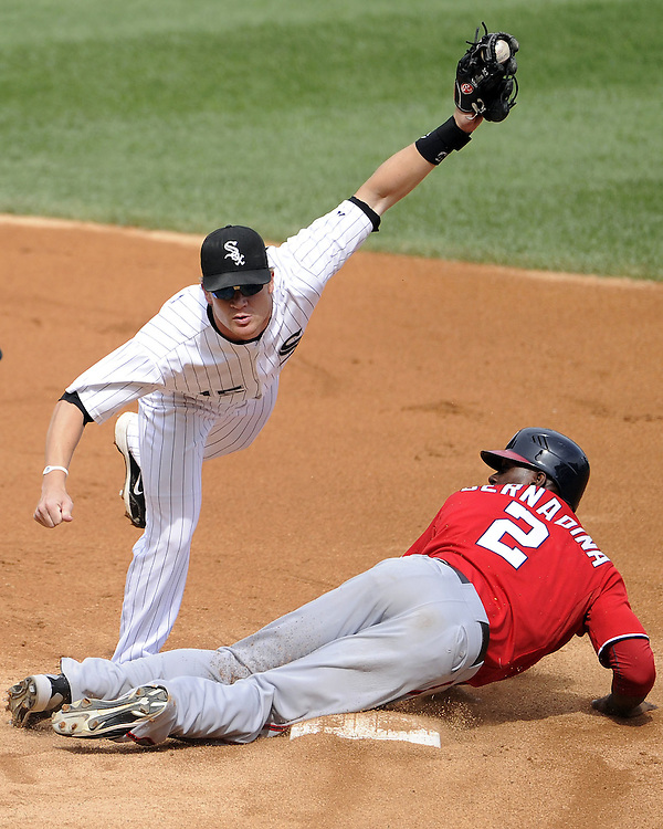CHICAGO - JUNE 25:  Gordon Beckham #15 of the Chicago White Sox tags out Roger Bernadina #2 of the Washington Nationals while attempting to steal second base in the third inning on June 25, 2011 at U.S. Cellular Field in Chicago, Illinois.  (Photo by Ron Vesely)   Subject:  Gordon Beckham;Roger Bernadina