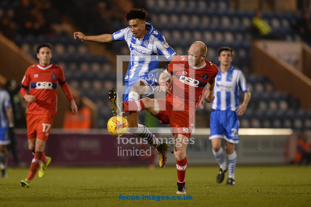 Kurtis Guthrie of Colchester United does battle with Jason Kennedy of Carlisle United during the Sky Bet League 2 match between Colchester United and Carlisle United at the Weston Homes Community Stadium, Colchester<br /> Picture by Richard Blaxall/Focus Images Ltd +44 7853 364624<br /> 07/01/2017