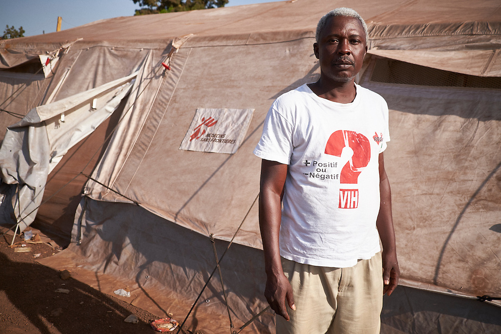 Responsable Jeunesse Alia Camara at the MSF mobile clinic in the neighbourhood of Dapompa, Conakry, Guinea on March 18, 2016. The man in is an imam from the local mosque and explains that he has been faithful to his wife since they have been married. He is relieved when his results show he is HIV negative. Bouboucar encourages the man to ask his wife to be tested also to be completely sure they are both HIV negative. MSF launched a HIV testing campaign in Conakry with the support of health authorities moving throughout several neighbourhoods throughout 2016.<br /> <br /> &quot;We convinced the youth to come and be screened by talking about  the importance of testing, they did not know about the different modes of transmission of HIV. After the campaign the majority of youth understand about how to avoid contracting HIV.&quot;<br /> <br /> Despite countries in West and Central Africa having a relatively low HIV prevalence (