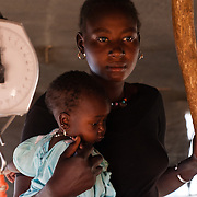 A mother discussing her child's malnutrition with staff at a Médecins Sans Frontières (MSF) health centre at the Mbera camp for Malian refugees in Mauritania on 3 March 2013.