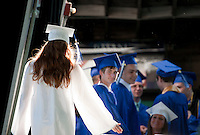 Samantha Chase walks up to join her classmates for their final gathering prior to the start of Inter Lakes Graduation at Meadowbrook Friday evening.  (Karen Bobotas/for the Laconia Daily Sun)