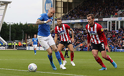 Marcus Maddison of Peterborough United takes on Harry Toffolo and Jorge Grant of Lincoln City - Mandatory by-line: Joe Dent/JMP - 12/10/2019 - FOOTBALL - Weston Homes Stadium - Peterborough, England - Peterborough United v Lincoln City - Sky Bet League One