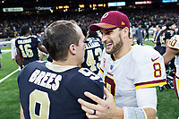 NEW ORLEANS, LA - NOVEMBER 19:  Drew Brees #9 of the New Orleans Saints talks after the with Kirk Cousins #8 of the Washington Redskins at Mercedes-Benz Superdome on November 19, 2017 in New Orleans, Louisiana.  Saints defeated the Redskins 34-31.  (Photo by Wesley Hitt/Getty Images) *** Local Caption *** Drew Brees; Kirk Cousins