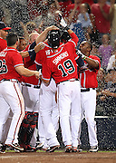 ATLANTA, GA - JUNE 08:  Left fielder Jason Heyward #22 of the Atlanta Braves (partially blocked) is mobbed by teammates centerfielder Michael Bourn #24, catcher Brian McCann #16, and shortstop Andrelton Simmons #19 after Heyward scored the winning run on a throwing error during the game against the Toronto Blue Jays at Turner Field on June 8, 2012 in Atlanta, Georgia.  (Photo by Mike Zarrilli/Getty Images)