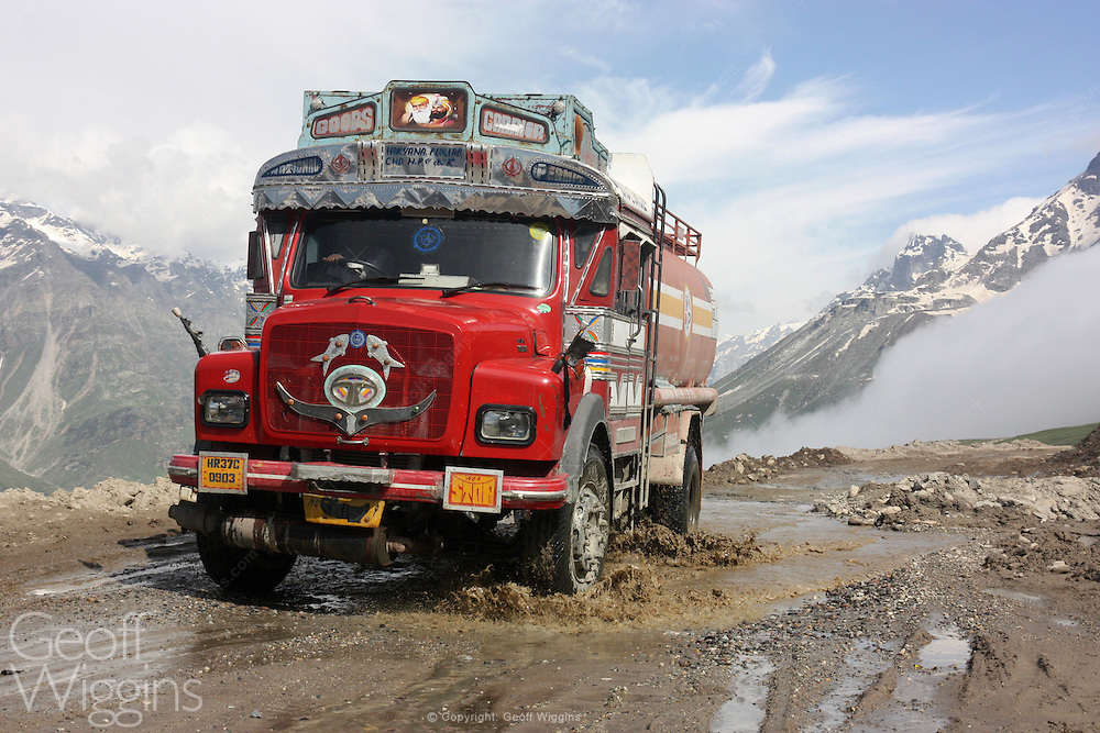 Indian LP SE 1613 fuel tanker climbs above the Himalayan clouds as it negotiates the hazardous Rohtang Pass on the road to Pang, Ladakh, Northern India
