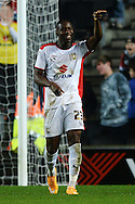 Benik Afobe of MK Dons celebrates scoring his sides fourth goal to make the scoreline 4-0 and completing his hat trick during the Sky Bet League 1 match between Milton Keynes Dons and Colchester United at stadium:mk, Milton Keynes<br /> Picture by Richard Blaxall/Focus Images Ltd +44 7853 364624<br /> 29/11/2014