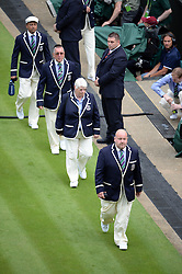 © Licensed to London News Pictures. 25/06/2014. LONDON, UK Wimbledon Tennis Championships 2014<br /> Day 3. Linesmen walk on court.  Photo credit : Mike King/LNP